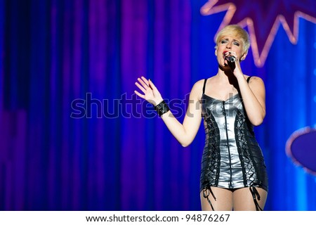 LAS PALMAS , SPAIN - FEBRUARY 9: Singer Jasi Santana, from Canary Islands, performing onstage during the Adult Costume Competition on February 9, 2012 in Las Palmas, Spain