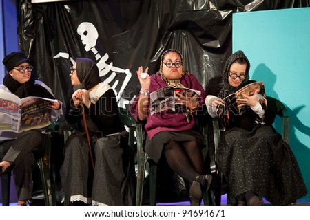 LAS PALMAS , SPAIN - FEBRUARY 7: Unidentified members from Afilarmonica Los Chancletas, from Canary Islands, perform during 2nd round of the Murgas contest on February 7, 2012 in Las Palmas, Spain
