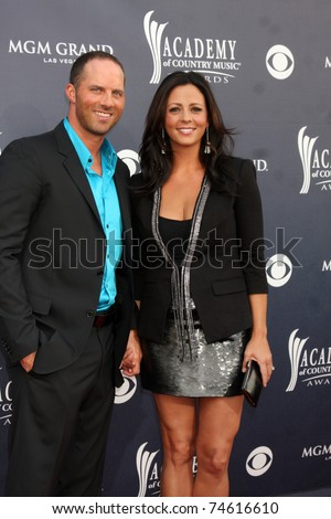 Sara Evans Husband http://www.shutterstock.com/pic-74616610/stock-photo-las-vegas-apr-sara-evans-amp-husband-arrive-at-the-academy-of-country-music-awards-at.html