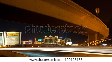 LAS VEGAS - APRIL 11: This long exposure on April 11, 2012, shows traffic along the Interstate 15 through Las Vegas with The Strip in the background. The Strip is approximately 4.2 mi (6.8 km) long.