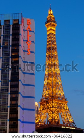 LAS VEGAS - AUG 18: The Eiffel Tower replica on the Paris Las Vegas Hotel on August 18, 2011 in Las Vegas. The back legs of this 1:2 scale replica protrude through the ceiling into the casino floor.