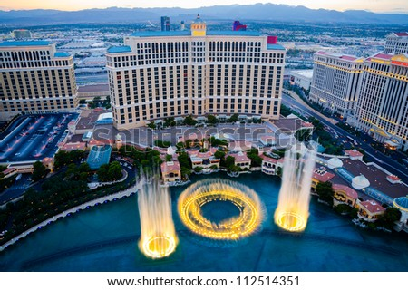 LAS VEGAS - AUGUST 14: Musical fountains at Bellagio Hotel & Casino on August 14, 2012 in Las Vegas. The Bellagio opened October 15, 1998, it was the most expensive hotel ever built at US$1.6 bn. - stock photo