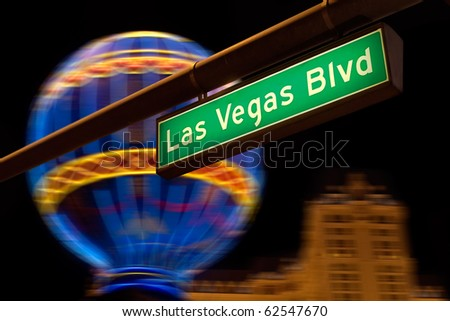 Las Vegas Boulevard street sign at night.