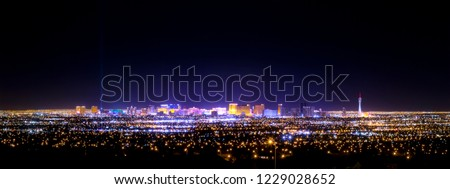 Las Vegas city at night strip skyline panorama with casinos and hotels from far distance