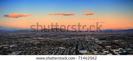Las Vegas City Skyline panorama with sunset, mountain, luxury hotels and streets.