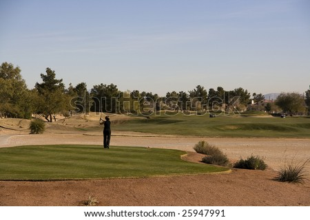 Las Vegas Desert Golf Course Woman Teeing Off