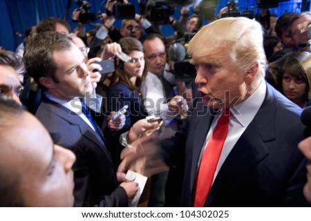 LAS VEGAS - FEB 2: Donald Trump (C) speaks with the media at his hotel on February 2, 2012 in Las Vegas, Nevada. Trump is endorsing Romney for president.