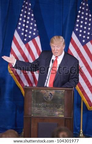 LAS VEGAS - FEB 2: Donald Trump gestures as he speaks at his Hotel on February 2, 2012 in Las Vegas, Nevada. Trump is endorsing Mitt Romney (off camera) for president.
