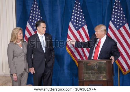LAS VEGAS - FEB 2: Mitt Romney (2nd-L) and his wife, Ann, listen as Donald Trump (C) endorses him for president at the Trump Hotel on February 2, 2012 in Las Vegas, Nevada.