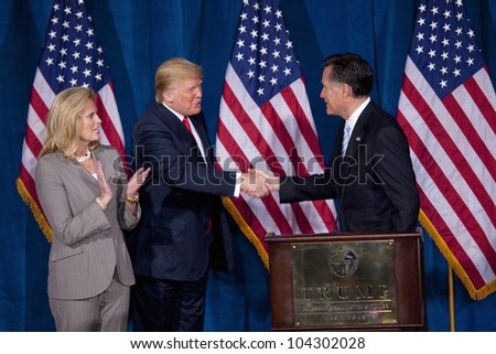 LAS VEGAS - FEB 2: Mitt Romney (R) shakes hands with Donald Trump as Romney's wife, Ann Romney, watches at the Trump Hotel on February 2, 2012 in Las Vegas, Nevada. Trump is endorsing Romney for president.