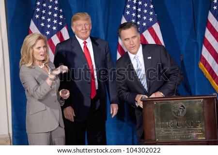 LAS VEGAS - FEB 2: Mitt Romney (R) speaks as Donald Trump and Romney's wife, Ann Romney, listen at the Trump Hotel on February 2, 2012 in Las Vegas, Nevada. Trump is endorsing Romney for president.
