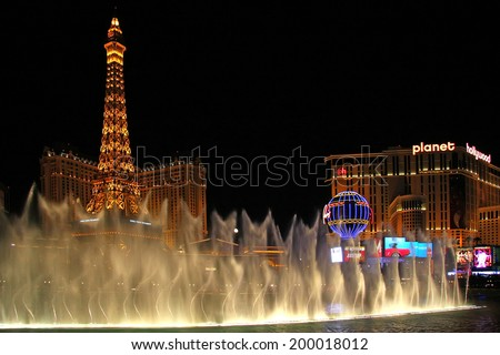 LAS VEGAS - JULY 27: The Paris Las Vegas hotel and casino on July 27, 2013 in Las Vegas. The Paris opened in 1999 and features a replica of the Eiffel Tower.