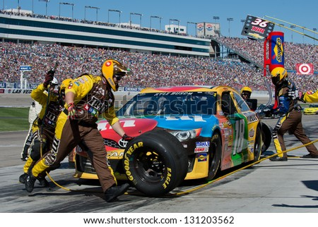 LAS VEGAS MAR 10 Kyle Busch in for a pit stop at the Nascar Kobalt 400 in Las Vegas NV on Mar 10 2013