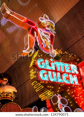 LAS VEGAS - MARCH 23:  March Madness generates frenetic activity along popular Fremont Street, also known as Glitter Gulch,  in downtown Las Vegas on March 23, 2013.