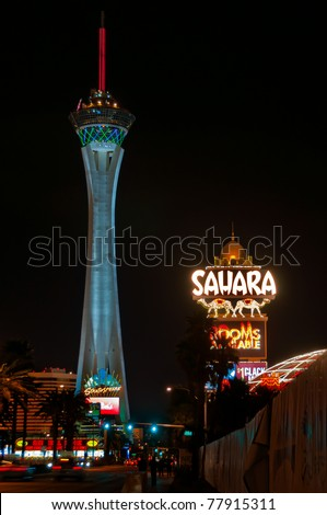 LAS VEGAS - MARCH 20: Stratosphere tower and Sahara Casino neon sign on March 20, 2011 in Las Vegas. Stratosphere tower is the tallest observation tower in the USA 1,149 ft (350.2 m). - stock photo