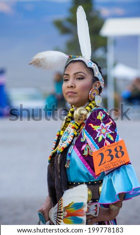 LAS VEGAS - MAY 24 : Native American woman takes part at the 25th Annual Paiute Tribe Pow Wow on May 24 , 2014 in Las Vegas Nevada. Pow wow is native American cultural gathernig event.