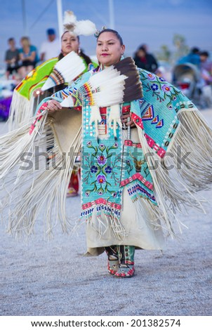 LAS VEGAS - MAY 24 : Native American women takes part at the 25th Annual Paiute Tribe Pow Wow on May 24 , 2014 in Las Vegas Nevada. Pow wow is native American cultural gathernig event.