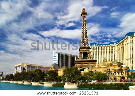 LAS VEGAS - MAY 2:View with palm trees on the replica of Eiffel Tower at Paris Hotel & Casini on May 2, 2007, NV. Designed after 1920s Paris with replicas of the Eiffel Tower and Arc de Triomphe
