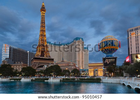 LAS VEGAS, NEVADA - FEBRUARY 11: Hotel Paris with half scale, 541-foot (165 m) tall replica of the Eiffel Tower at twilight on February 11, 2012 in Las Vegas, Nevada.