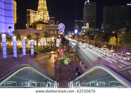 LAS VEGAS, NEVADA - OCTOBER 6:  The Eiffel Tower, Planet Hollywood and other landmarks entertain tourists on a warm desert night, on October 6, 2010 in Las Vegas, Nevada.