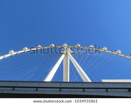 Las Vegas, Nevada, United States - 12 28 2014: White Fortune Wheel with a clean sky #1034935861