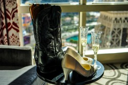 Las Vegas, NEVADA, USA - Boots and High Heels with Champagne with a view of the Paris Hotel Eiffel Tower
