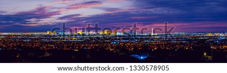 Las Vegas night city skyline panorama with strip hotels and casinos and old Vegas.