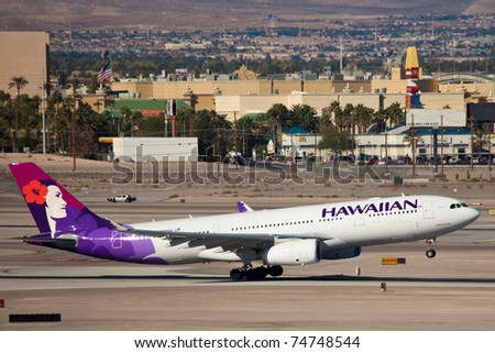 LAS VEGAS - NOVEMBER 11: A330 Hawaiian climbs after take off from McCarran in Las Vegas, USA on November 11, 2010. Hawaiian is the only airline based in hawaii that serves international destinations