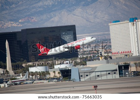 LAS VEGAS - NOVEMBER 12: Airbus A320 Virgin America climbs after take off from McCarran in Las Vegas, NV, USA on November 12, 2010. A320 is the biggest rival for the most popular middle range plane B737