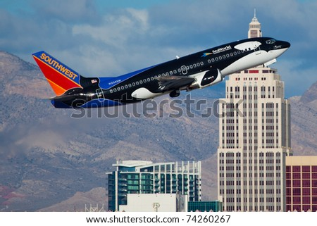LAS VEGAS - NOVEMBER 12: Boaing 737 Southwest climbs after take off from McCarran in Las Vegas, USA on November 12, 2010. Plean is wearing very speical livery called SHAMU - SeaWorld, FL Advertising