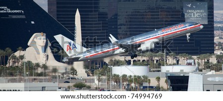 LAS VEGAS - NOVEMBER 15: Boeing 757 American Airline climbs after take off from McCarran airport in Las Vegas, USA on November 15, 2010. 757 is middle range passenger plane used by over 100 airlines - stock photo