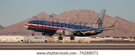 LAS VEGAS - NOVEMBER 14: Boeing 737 American Airline lands on McCarran airport in Las Vegas, USA on November 14, 2010. American Airlines is one of the biggest and oldest major American airlines - stock photo