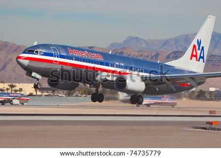 LAS VEGAS - NOVEMBER 14: Boeing 737 American Airline lands on McCarran airport in Las Vegas, USA on November 14, 2010. American Airlines is one of the biggest and oldest major American airlines