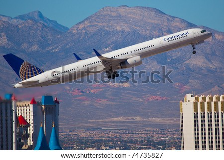 LAS VEGAS - NOVEMBER 14: Boeing 757 Continental climbs after take off from McCarran in Las Vegas, USA on November 14, 2010. Continental is no longer exist airline been merged into the United Airline