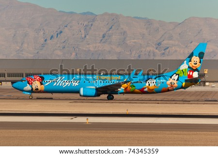 LAS VEGAS - NOVEMBER 12: Boeing 737-400 Lasaka Airlines taxing on McCarran airport in Las Vegas, USA on November 12, 2010. Plane is wearing Disney Livery which is rated best painted plane in the world