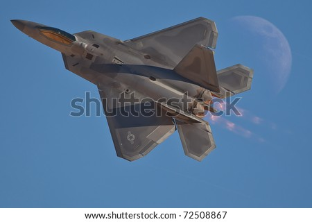LAS VEGAS - NOVEMBER 13: F-22 Raptor, only 5 generation plane performing high speed pass during annual air show called Aviation Nation on November 13, 2010 in Las Vegas, NV, USA