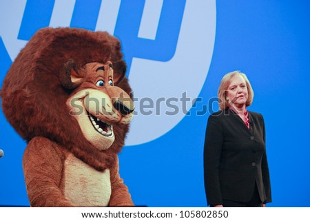 LAS VEGAS, NV - JUNE 5, 2012: HP president and chief executive officer Meg Whitman delivers an address to HP Discover 2012 conference with cartoon character lion on June 5, 2012 in Las Vegas, NV