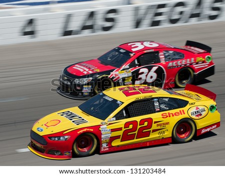 LAS VEGAS, NV - MAR 10: Joey Logano leads JJ Yeley at the Nascar Kobalt 400 in Las Vegas, NV on Mar 10, 2013
