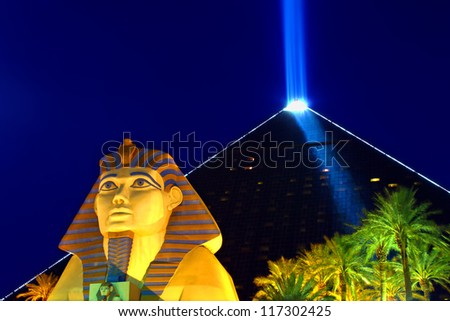 LAS VEGAS - OCTOBER 29: Luxor Las Vegas on October 29, 2011 in Las Vegas. Luxor opened in 1993 and contains a replica of the Great Sphinx of Giza and a pyramid shaped building with a spotlight.