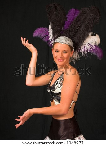 Las Vegas showgirl theme model with hands and feathers in hat