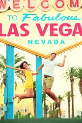 Las Vegas Sign. Happy people jumping having fun in front of Welcome to Fabulous Las Vegas sign. Beautiful young couple on the Strip cheerful and excited during travel holidays vacation, Nevada, USA.