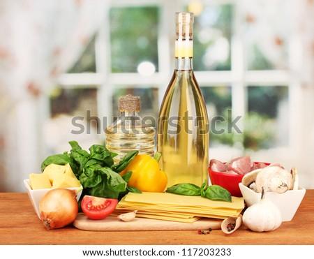 Lasagna ingredients on bright background