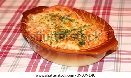 lasagna on checked tablecloth