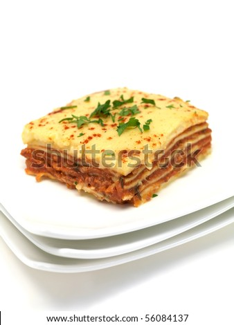 Lasagna plated up and isolated against a white background