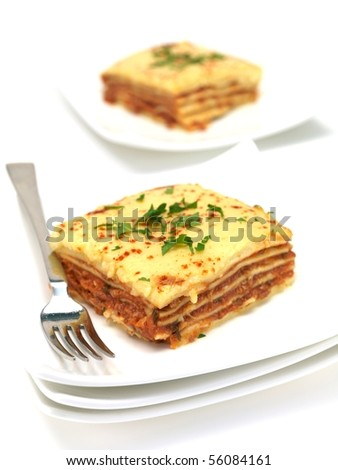 Lasagna plated up and isolated against a white background - stock photo
