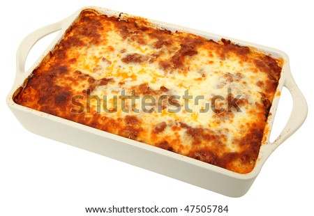 Lasagna uncut in baking dish over white background.