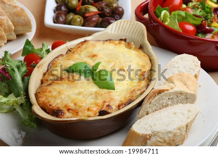Lasagna with Italian salad and baguette