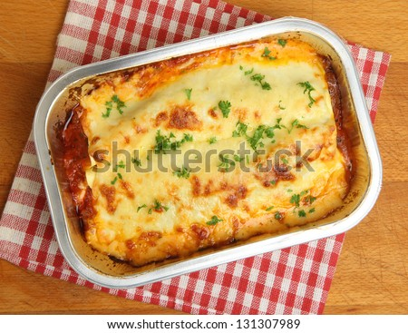 Lasagne ready meal in foil container.