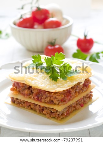 Lasagne with meat, tomato and cheese. Selective focus - stock photo
