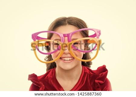 Laser correction. Eye exercises to improve eyesight. Girl kid wear big eyeglasses. Eyesight and health. Optics and eyesight treatment. Effective exercise eyes zooming. Child happy with good eyesight.